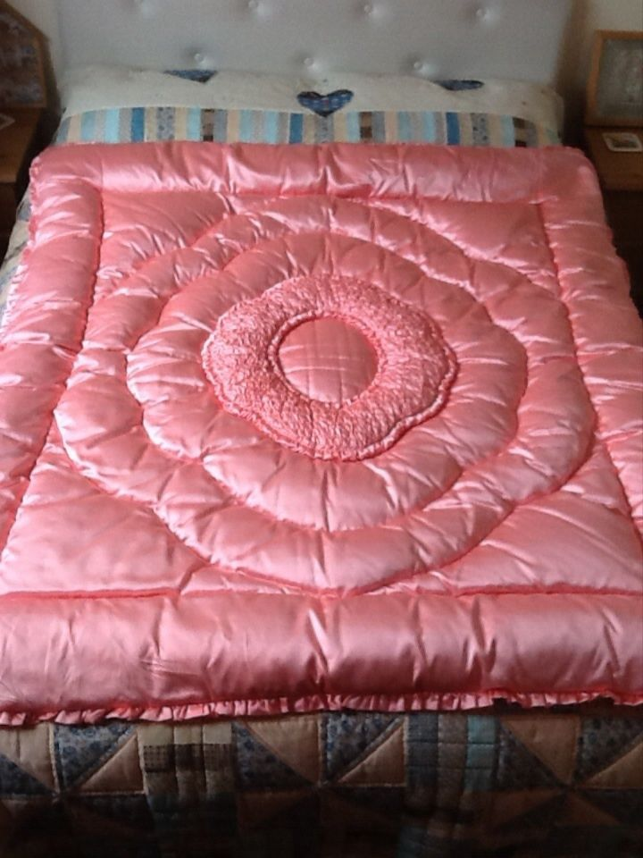Pink eiderdown. My lovely Nana had these in all the bedrooms.