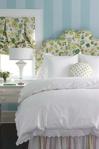 Soooo pretty! Love The wallpaper, headboard and drapes and the lovely bed skirt with pastel stripes!