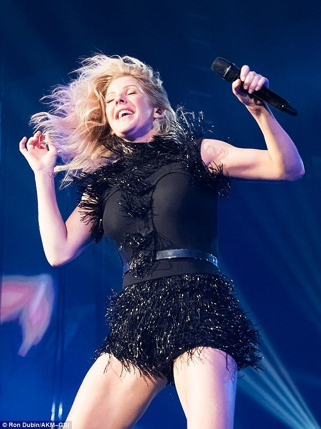 Work it! Ellie Goulding barely broke a sweat as she rocked out in a glitzy playsuit during her Delirium World Tour in Florida on Saturday