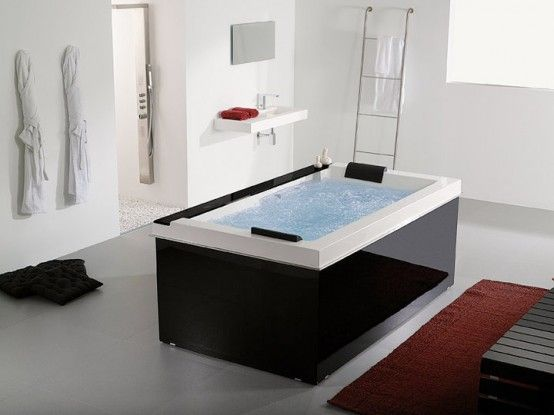 Pacific spa tub by Systempool with a built-in music system which is capable to play MP3s and has radio, clock and Bluetooth.