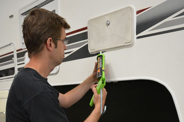 Caulking around the exterior shower in our camper: http://www.truckcampermagazine.com/camper-tech/how-to-inspect-and-repair-camper-seals