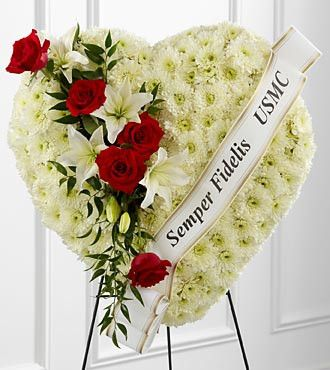 The FTD® Salute to a Patriot™ Standing Heart is the perfect tribute to a fallen marine. A pearly white heart consisting of chrysanthemums is accented with an arrangement of red roses, white Asiatic li