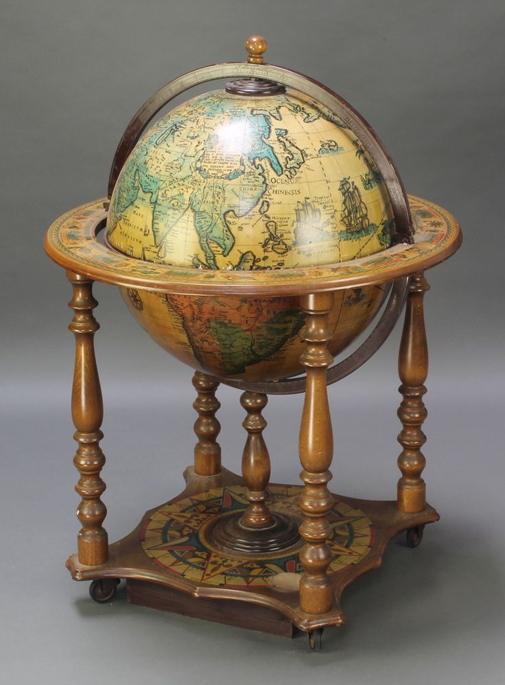 "Lot 897, A mid 20th Century cocktail cabinet in the form of a terrestrial globe, 36""h x 27 1/2""diam. est £50-75"