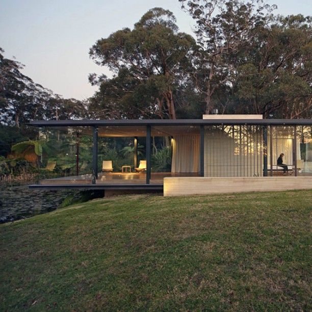 Glass and steel pavilion by Matthew Woodward cantilevers over a natural dam. This glass, steel and sandstone pavilion near Sydney protrudes over the edge of a natural dam.