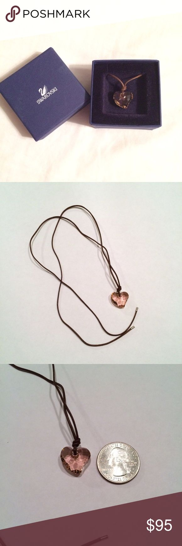 ⚡️SALE⚡️ Swarovski Heart Pendant Necklace NWOT. Authentic, perfect condition, never worn. The first time I took it out of the box was to take these pictures. Brown 24 inch cord. (Quarter for size reference). Light pink heart, picture makes it look orangey but it is pink. Original box included. Swarovski Jewelry Necklaces