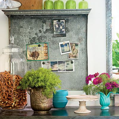 Great look - great idea!  Salvaged Bulletin Board  A salvaged metal radiator cover that's equipped with magnets hangs as the kitchen bulletin board.
