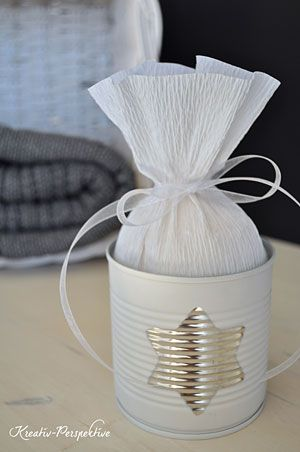 Empty cans with a little spray paint and crepe paper can quickly transform in an original gift box. - Tutorial