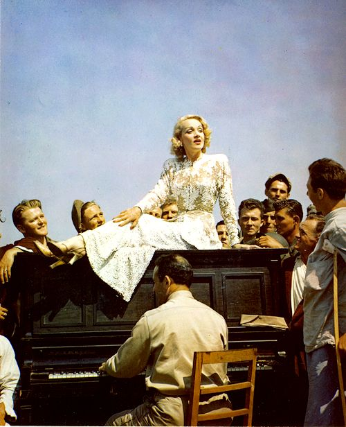 Marlene Dietrich serenades the soldiers at an army evacuation hospital near the Italian front lines, May 1944. Dietrich was awarded the US Medal of Freedom and the French Legion d'honneur for her war work.