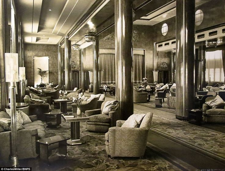 A unique photo album, documenting the birth of the famed RMS Queen Mary ship has now come to light 80 years after its launch. Pictured: the opulent cinema and dance hall