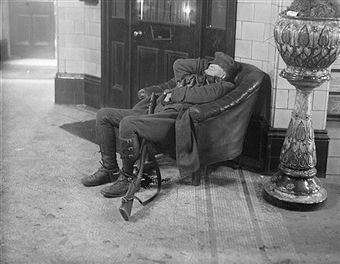 WWI, Dec 1916; A soldier asleep in a chair at Waterloo Hostel. -Getty Images