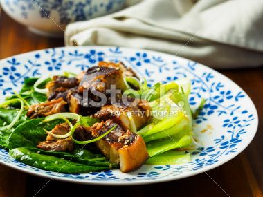 Oriental pork belly with pok choi and soy sesame dressing.Oriental pork belly with pok choi and soy sesame dressing.