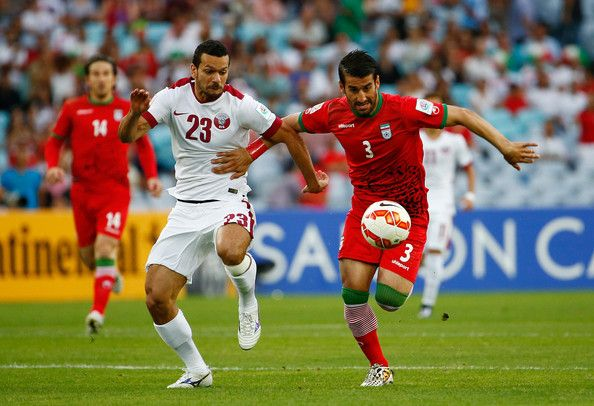 Ahmed El Sayed of Qatar fights the ball against Ehsan Hajsafi of Iran during the 2015 Asian Cup match between Qatar and IR Iran at ANZ Stadium on January 15, 2015 in Sydney, Australia. (January 14, 2015 - Source: Daniel Munoz/Getty Images AsiaPac)
