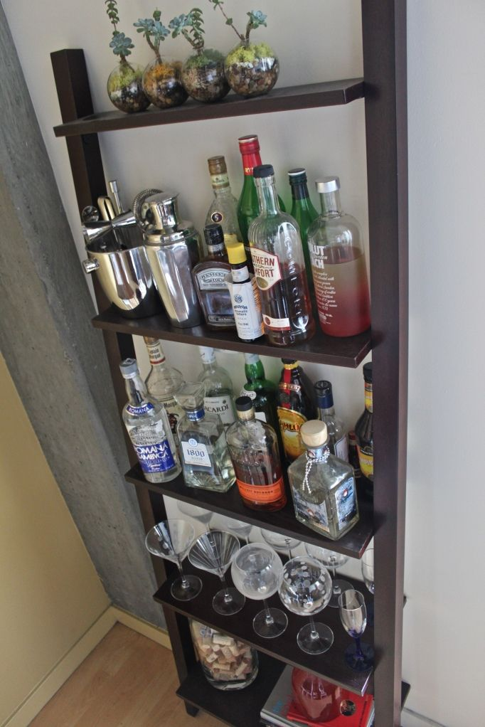 Leaning bookshelf bar... I have one of these I need to make into one!