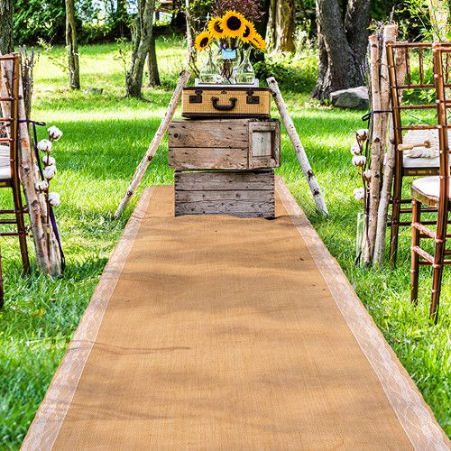 Burlap Aisle Runner with Delicate Lace Borders Let the beauty of lace guide you down the aisle with this delicately designed burlap aisle runner. Delightfully intricate white floral lace runs down eit
