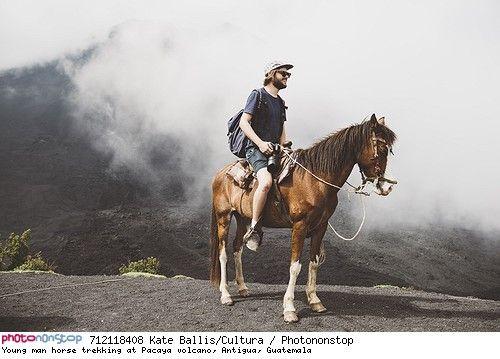 Young man horse trekking at Pacaya volcano, Antigua, Guatemala - Cheval, chevaux, animaux