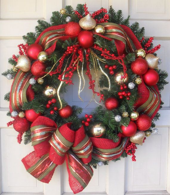 24 Artificial Spruce Christmas Door Wreath. Made of quality materials. Features: Custom designed, hand made 4 layer ribbon. Variety of Red