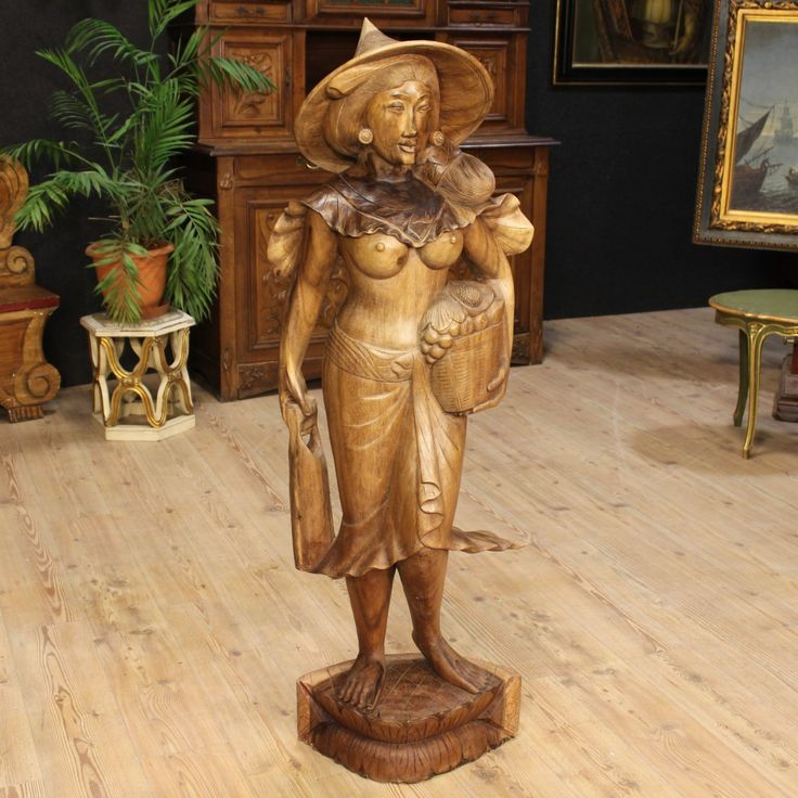 Price: 1350€ Big Eastern sculpture of the 20th century. Work made by ornately carved wood depicting female character expertly finished. Statue carved from a single block of wood, for decorators, antique dealers and collectors. In good conditions with some small signs of the time. #antiques #antiquariato Visit our website www.parino.it