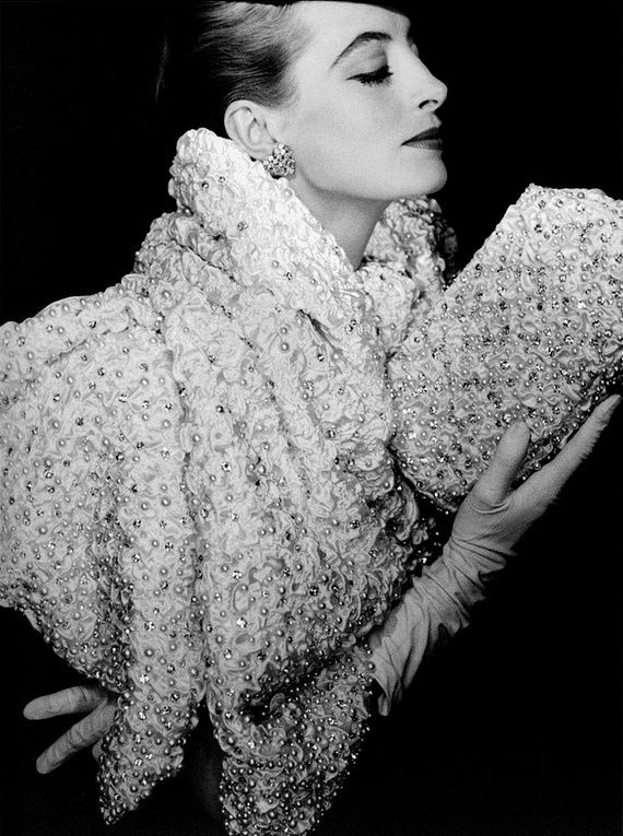 1956 Capucine is wearing a shimmering white satin stole, encrusted with gleaming pearls and matching evening clutch, both by Christian Dior, photo by Henry Clarke, Vogue