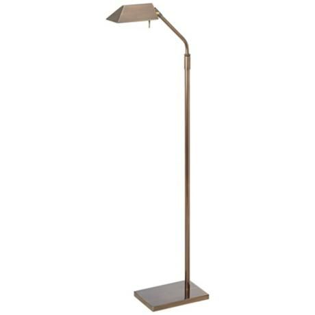 """Antique Brass Halogen Pharmacy Floor Lamp $249.99      Antique brass finish.     Great for reading.     Pharmacy style shade.     Takes one 50 watt halogen bulb (included).     Adjusts 46"""" to 64"""" high.     Shade measures 6"""" long, 4"""" wide."""