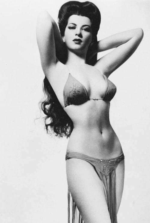 """Sherry Britton, born Edith Zack on 7/28/18 in New Brunswick, NJ. Died on 4/01/08 of natural causes. An Actress and Burlesque performer of the 1930s and early 1940s. She was 5' 3"""" tall and had an 18"""" waist. She was said to have a """"figure to die for"""". She performed in many theaters and clubs and said she enjoyed stripping in night clubs. She also performed for the troops during WWII. She was married twice and once said she'd been engaged 14 times!"""