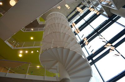 UB's new Angelos Law Center gets ready for its close-up: The University of Baltimore School of Law's new building is 12 stories of neon greens, yellows and oranges, with winding staircases and windows at every turn. #law #education #baltimore #maryland #news