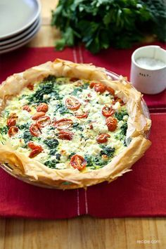 Never made a quiche before, but it sounds like a lovely idea - Spinach, Tomato and Feta Quiche