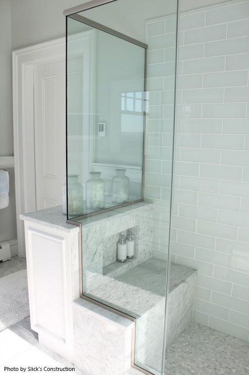 Walk In Shower With A Back Shower Seat Glass Shower Doors White Subway Tile All Around And A