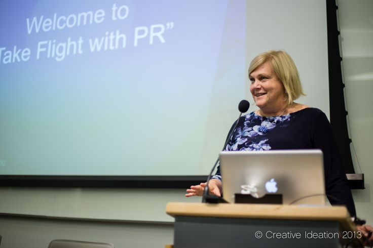 """Denise Keyes, Senior Associate Dean, Public Relations and Corporate Communications Program, Georgetown University School of Continuing Studies welcoming attendees to the Council of Public Relations Firms """"Take Flight with PR"""" program."""