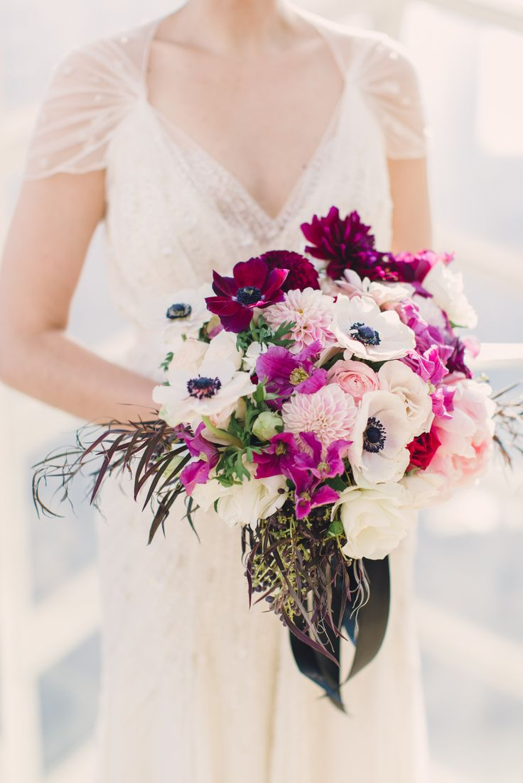 Purple and white anemone bridal bouquet | Lauren Fair Photography | Sullivan Owen Floral and Event Design | www.theknot.com