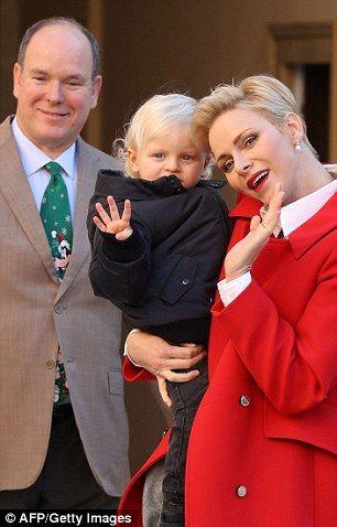 Charlene looked elegant in her festive red jacket...