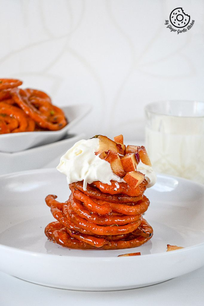 Instant Peach Jalebi Topped with Whipped Cream and Pistachio