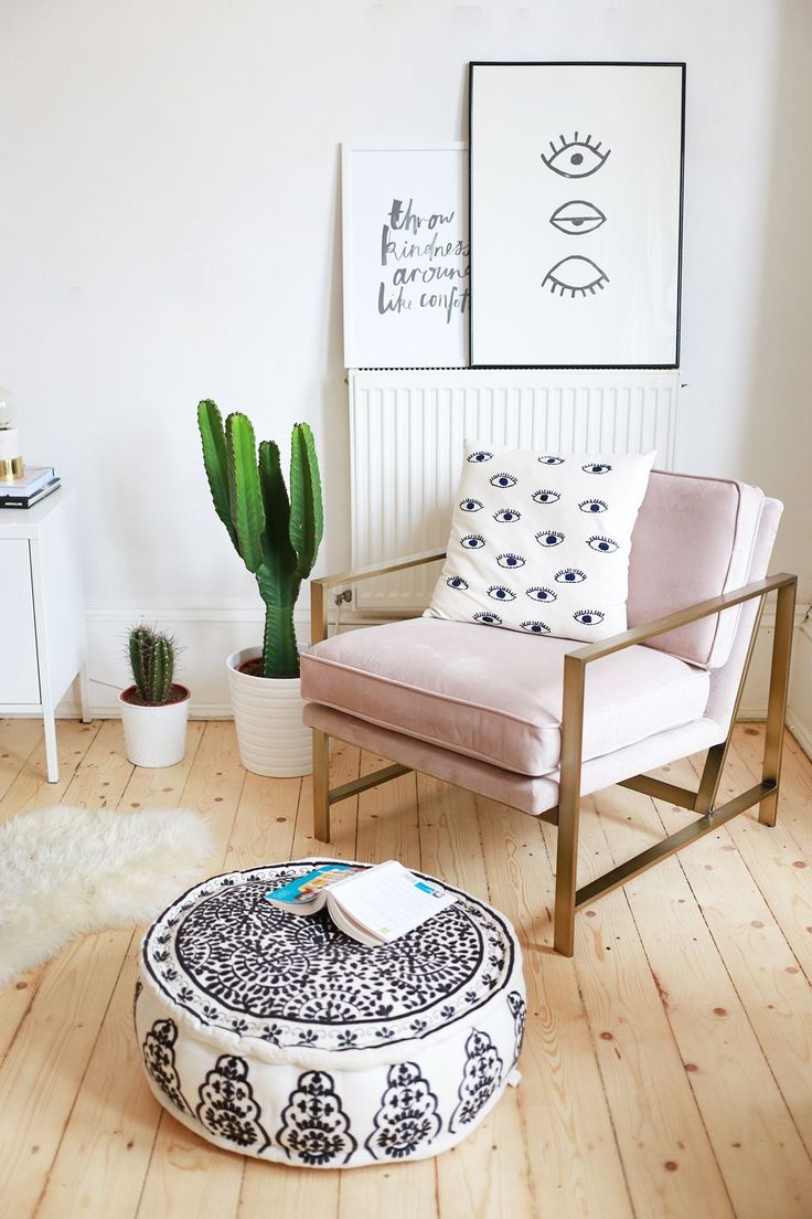 pink chair with eye pillow and cacti