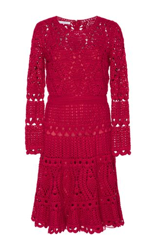 This dress by **Oscar de la Renta** is crocheted in a romantic red with carefully placed eyelets for added appeal.