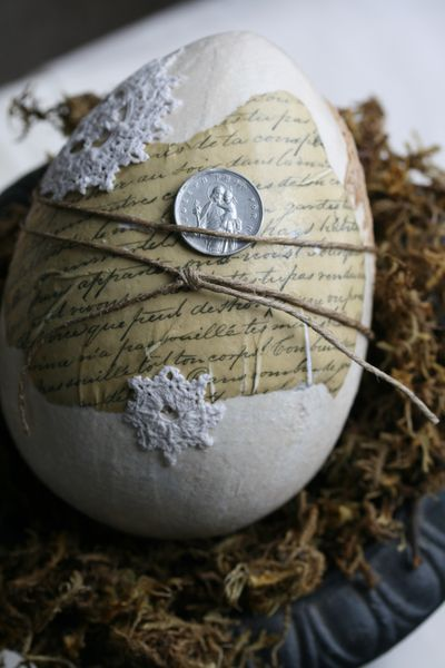 Yes~vintage manuscripts and linens, hemp twine, and religious artifacts was used to create this egg