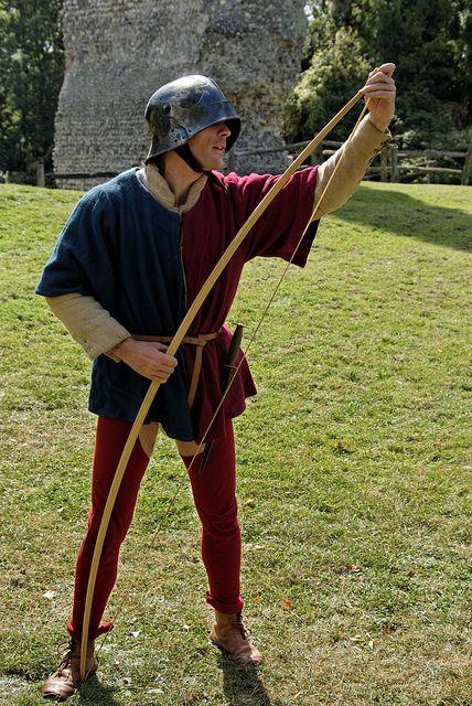 English archer stringing his longbow