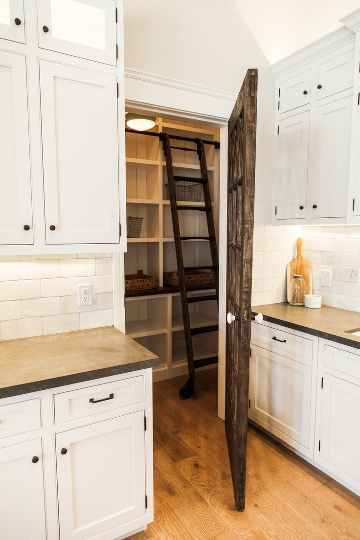695 best diy kitchen images on pinterest kitchen diy kitchen a reclaimed barn wood door opens to a kitchen pantry filled with a rustic ladder on rails lining floor to ceiling shelves