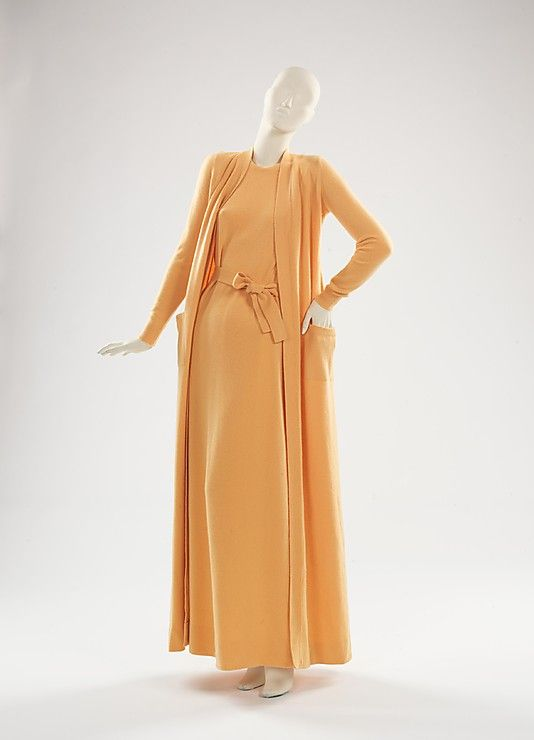 Evening ensemble   Halston (Roy Halston Frowick, American, 1932-1990)   United States, circa 1975   Material: wool   This evening ensemble is an iconic example of Halston's work, which can be seen by the simple silhouette and use of cashmere for evening wear. The columnar dress hangs on the body, allowing the tie-belt to accent the waist. Enhancing the slim, lithe look is the full length cardigan sweater   The Metropolitan Museum of Art, New York