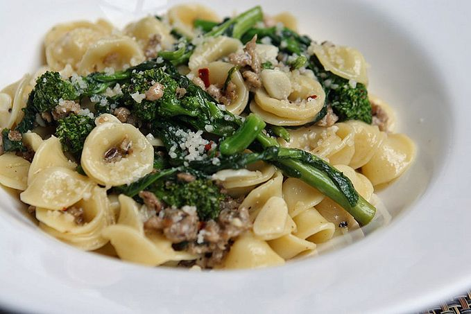 "In Italy, broccoli rabe is also known as rapini and cime di rapa. It has a slightly bitter flavor that nicely compliments Italian foods, in this case Italian sausage and orecchiette pasta. Orrechiette means ""little ears"" in Italian, and the bowls of the orrechiette tend to trap bits of all the ingredients and sauce making every bite...Read More »"