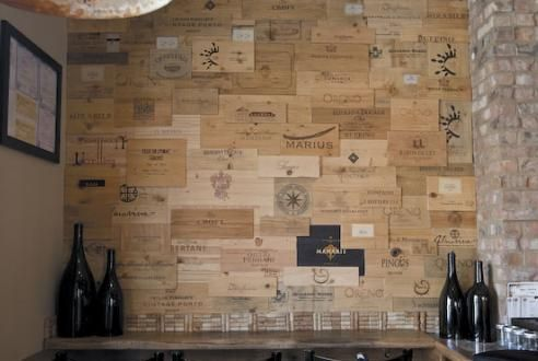 Wine crate wall. I would love to do this in our future wine cellar