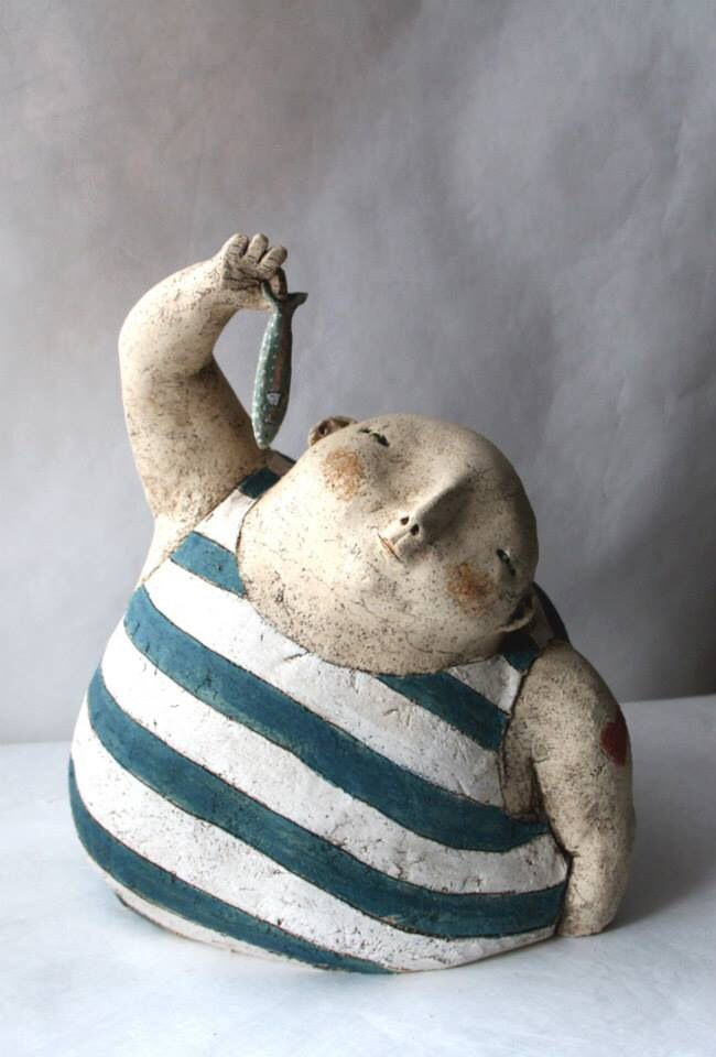 Could be a neat clay project: slab base as water, half pinch pot as body sticking out, add coil arms, and neck, and a ball for a head. Hair with garlic press. Draw in features, swim suit, etc. with toothpick. Ann-Sophie Gilloen.