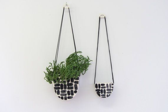 A half moon shaped hanging planter that can be hung in a window or flush on a wall. Hang one or hang three, they are sure to add a little life to your