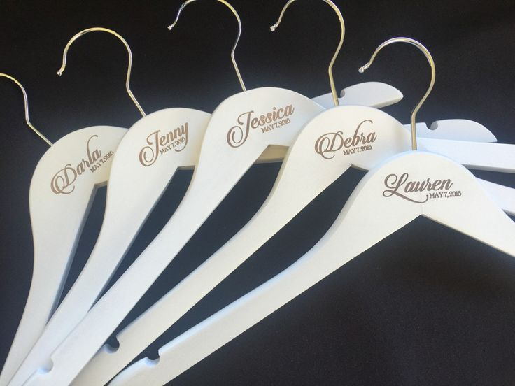 Classic ETCHED custom coat hangers for the perfect wedding bridal party gift. Includes any name and date etched into the wood uniquely. by louiseexclusivelyyou on Etsy