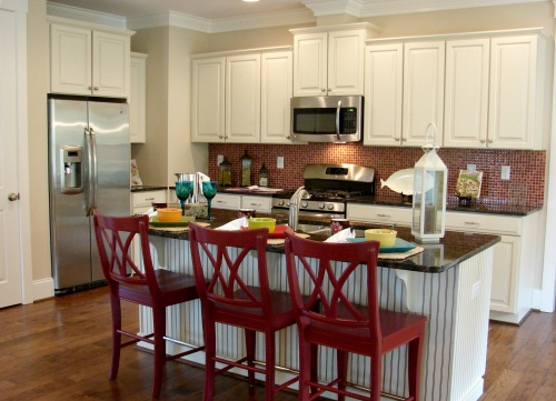 Cream and red country kitchen with nautical accents.