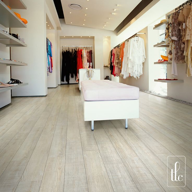New England - 5261 -   The simplicity and subtleness of New England creates a fresh look and perfectly enhances any interior.  The cool tones encapsulated within each authentically replicated plank fills any environment with light and radiance, whilst the floorings commercial grade wear layer and surface treatment withstands the demands of high foot-traffic areas.  (Straight laid planks with Grey Grouting Strip)