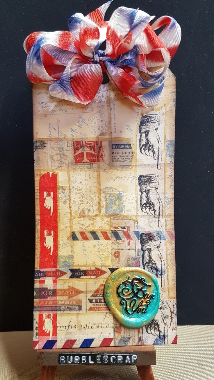 A ppstage themed tag with oxides and Tim Holtz designer tape....