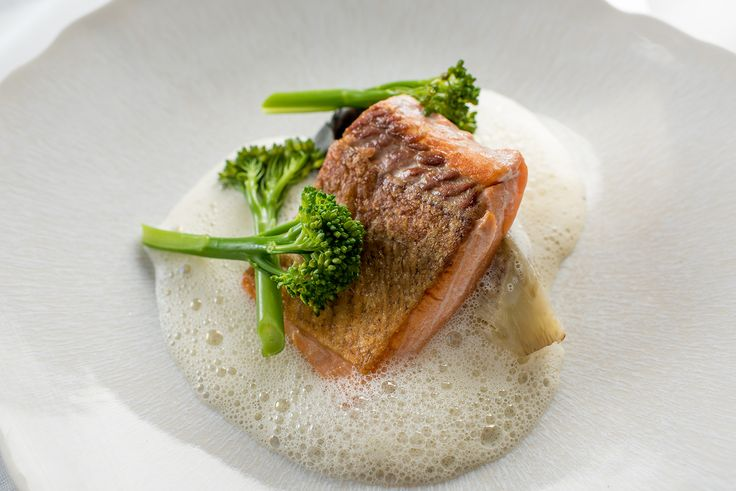 In this delicious Graham Campbell recipe, sea trout is served with a creamy scallop velouté, scallop tortellini and vibrant Tenderstem® broccoli