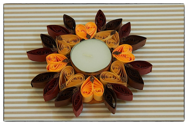 These water resistant quilled candle holders are great option. They make good decorative item or you can just pick them for Diwali gifting.