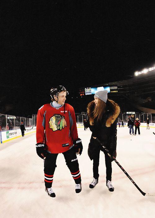Patrick Kane skates with Amanda Grahovec during the NHL Stadium Series family skate at Soldier Field