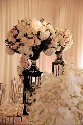tall black birdcages, fluffy white flowers