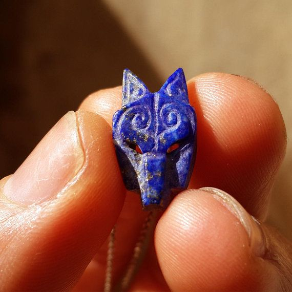 Check out this item in my Etsy shop https://www.etsy.com/listing/584571310/wolf-necklace-lapis-lazuli-wolf-silver